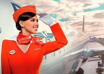 Aeroflot airline company: stewardess is standing in front of the airplane